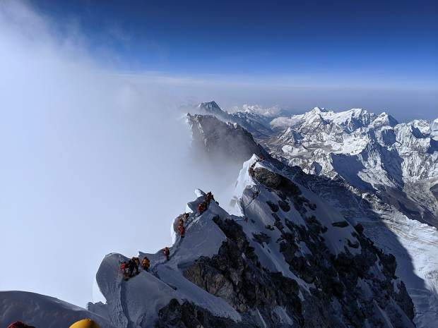 Climbers make their way to and from the South Summit in the background toward the real summit of Mount Everest. Caine said his team was able to avoid long delays reported by some parties on the final ridge.