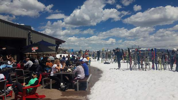 Crowds hung out Saturday at the Sundeck atop Aspen Mountain for another bonus weekend of skiing.