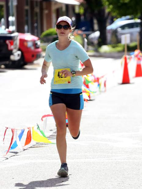 Women's race winner Amy Rollins approaches the finish of the Basalt Half Marathon on Saturday, June 8, 2019, at Lions Park in Basalt.