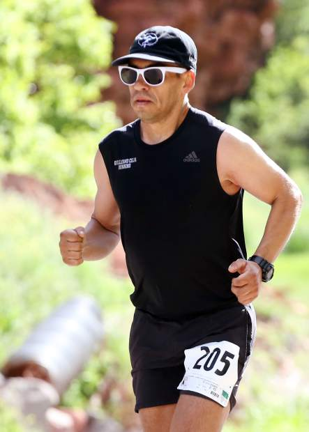 Eventual runner-up Guillermo Ceja runs down Frying Pan Road during the Basalt Half Marathon on Saturday, June 8, 2019, with a finish at Lions Park in Basalt.