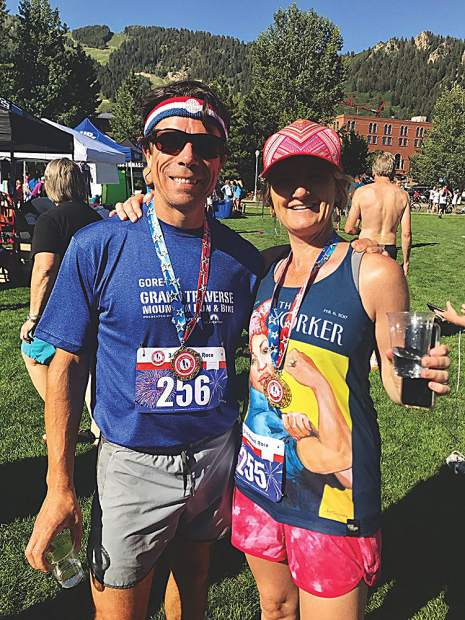 Running, then wine. Ben Brennan, a jack rabbit runner and wine distributor, with his wife, Jen, at the Boogie's race.