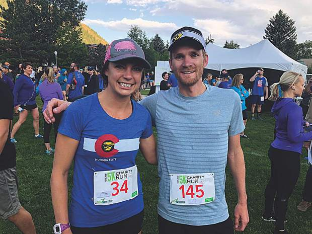 Maggie Callahan, the top female finisher at the Food & Wine Celebrity Chef 5K in 2018, beside another fast runner, Craig Lewis.