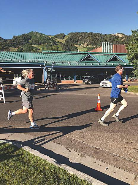 Aspen Times Weekly wine writer Kelly Hayes, at left, finishes the 2018 Food & Wine Classic 5K. Hayes has maintained a daily running streak for several years now, clocking at least a mile a day every single day.