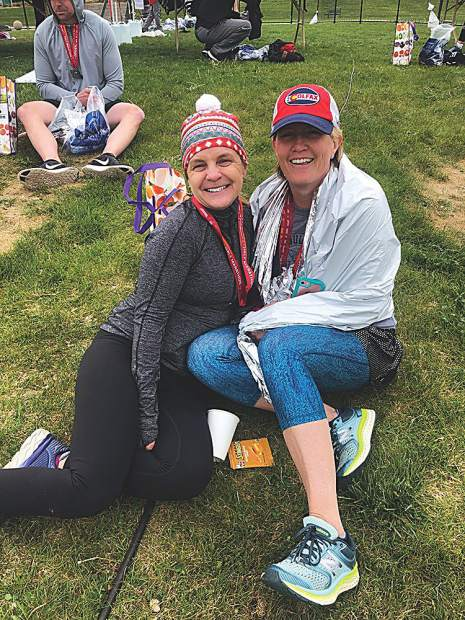 Amy Clemens Harvey and a friend at the finish area after running Denver's Colfax Half-Marathon in May.