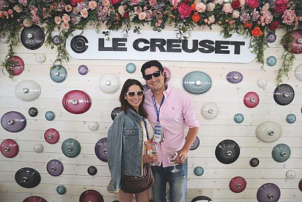 Jessie and Jon Greechan strike a pose beside Le Creuset's installation at the Grand Tastings.