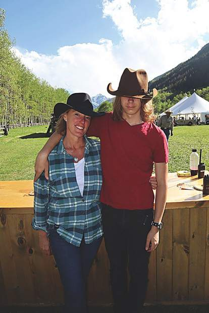 Marcy Kneiper with Orion Events and her son Morgan as her cowboy helper.