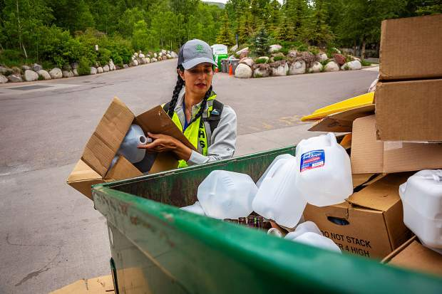 Julia Farwell of the City of Aspen's Enivronmental Health and Sustainability department cleans up messes made by users of the Rio Grande Recylcing Center Sunday.