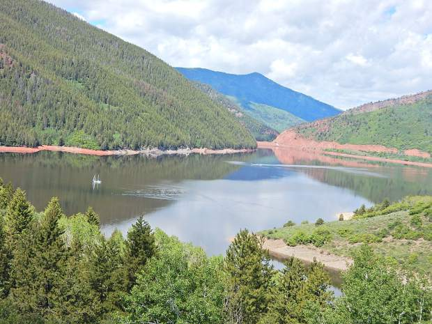 Boats explore Ruedi Reservoir before a storm rolls in on Saturday. The reservoir was 86 percent full on Thursday. The U.S. Bureau of Reclamation expects it to fill sometime after July 4.