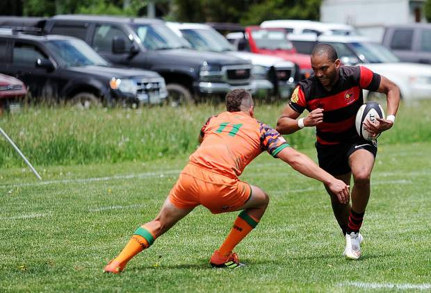 Aspen rugby player DJ runs into Steamboat's territory during Steamboat's home opener on Saturday, June 15, at Whistler Park.