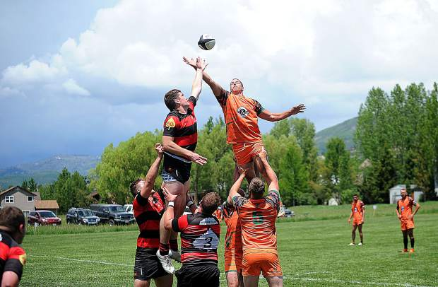 Steamboat Rugby's Taylor Anderson battles Aspen's Chris Campbell for the ball during Steamboat's home opener on Saturday, June 15, at Whistler Park. The Aspen Gentlemen went on to defeat the Steamboat Fighting Bull Trout 20-15.