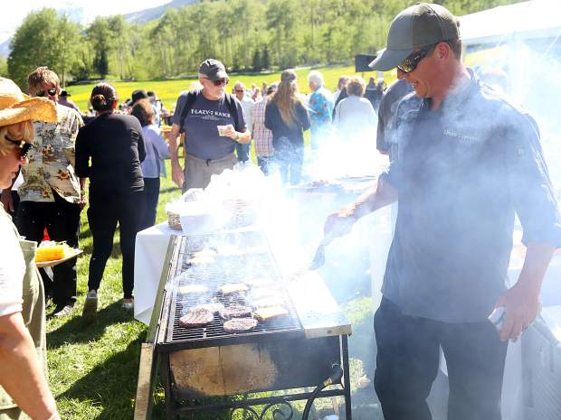Hamburgers are grilled at the T-Lazy-7 Ranch 80th anniversary hoedown on Saturday, June 8, 2019. (Photo by Austin Colbert/The Aspen Times)