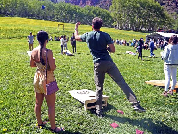 People play cornhole at the T-Lazy-7 Ranch 80th anniversary hoedown on Saturday, June 8, 2019. (Photo by Austin Colbert/The Aspen Times)