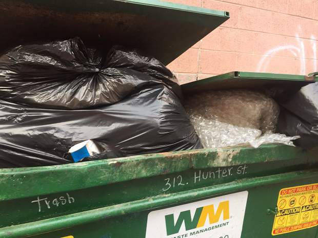 Unlocked trash from two businesses in the alley between Hopkins Avenue and Cooper Street is a violation of the city's solid waste ordinance and an attractant for bears.