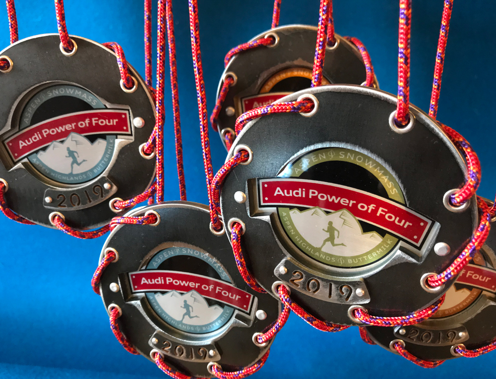 For the Audi Power of Four Race: Custom designed and hand-fabricated steel and mixed-media medallions by Colorado metal artist, Lisa Issenberg (business name: Kiitella).