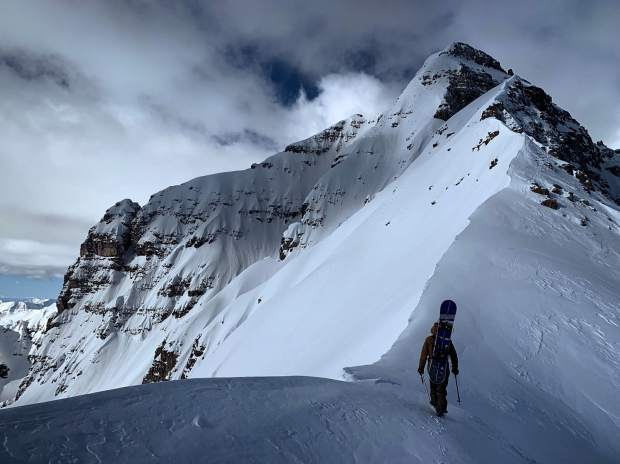 Chad Otterstrom of Breckenridge hikes along the ridge toward his line near the summit of Pyramid Peak in April,