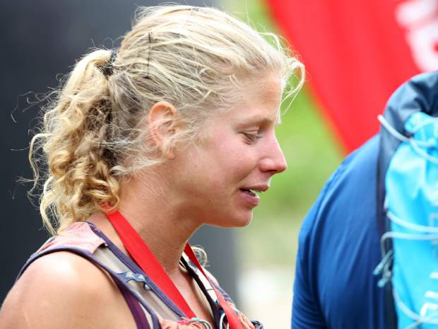 Boulder's Rea Kolbl hangs out after finishing as the top woman in the Audi Power of Four trail run on Saturday, July 13, 2019. (Photo by Austin Colbert/The Aspen Times)