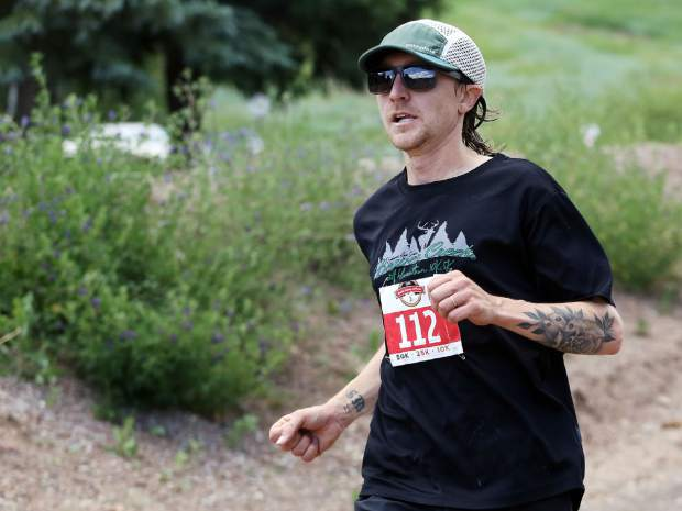 Carbondale's Joseph DeMoor approaches the finish of the Audi Power of Two trail run on Saturday, July 13, 2019, in Snowmass Village. He finished second. (Photo by Austin Colbert/The Aspen Times)