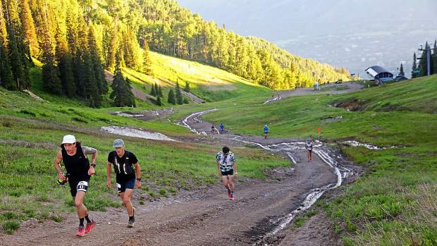 Runners make their way up Aspen Mountain in the early stages of the Audi Power of Four 50k trail run on Saturday, July 13, 2019. (Photo by Austin Colbert/The Aspen Times)
