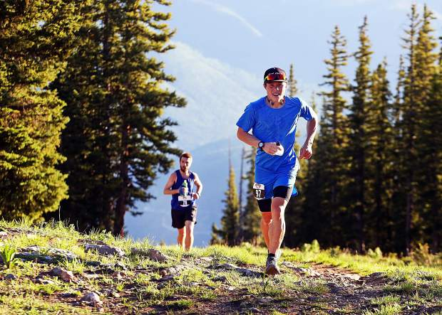 Aspen's Max Taam holds a small lead over Linden Shoup of Colorado Springs during the early stages of the Audi Power of Four trail run on Saturday, July 13, 2019. (Photo by Austin Colbert/The Aspen Times)