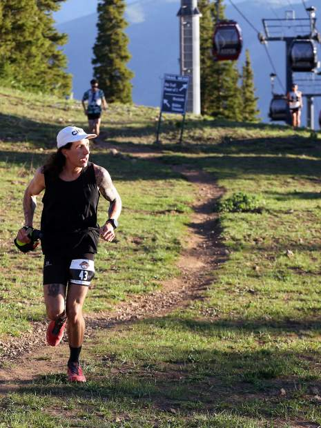 Leadville's Bryan Kerl reaches the top of Aspen Mountain during the Audi Power of Four trail run on Saturday, July 13, 2019. (Photo by Austin Colbert/The Aspen Times)