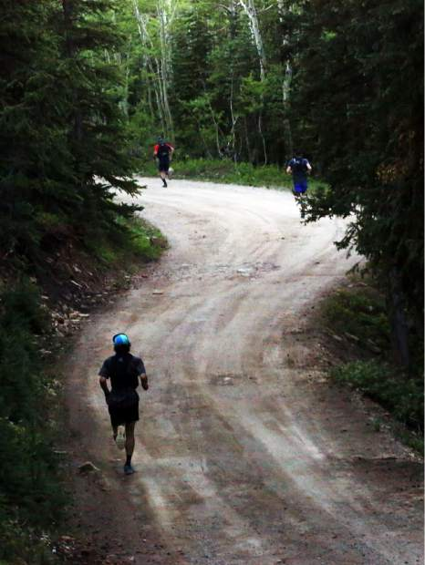 Runners make their way down the backside of Aspen Mountain during the Audi Power of Four trail run on Saturday, July 13, 2019. (Photo by Austin Colbert/The Aspen Times)