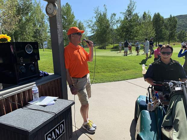 Challenge Aspen CEO Jeff Hauser talks prior to the 16th annual Challenge Aspen golf classic on Monday, July 29, 2019, at Snowmass Club.