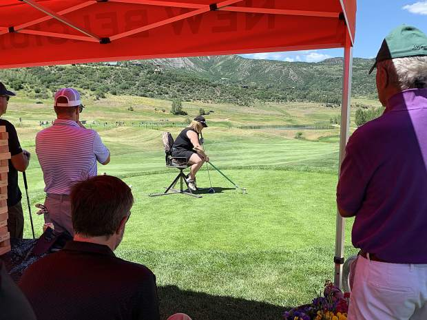 A golfer tries hitting the ball like an adaptive athlete during the 16th annual Challenge Aspen golf classic on Monday, July 29, 2019, at Snowmass Club.