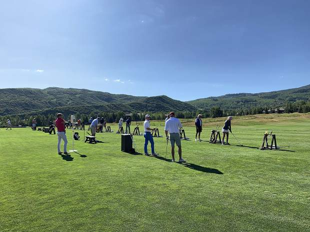 People take to the driving range ahead of the 16th annual Challenge Aspen golf classic on Monday, July 29, 2019, at Snowmass Club.