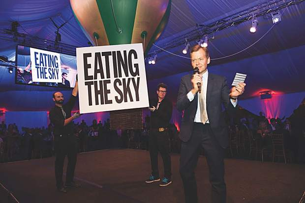 Oliver Barker, deputy chairman of Sotheb's Europe, drives the bidding sky high for John Giorno's