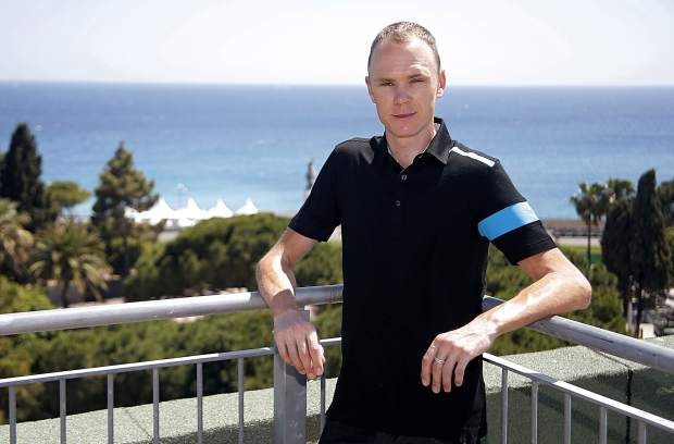 "FILE - In this June 18, 2013 file photo, cyclist Chris Froome of Team Sky poses for photographers before a meeting with journalists in Nice, southern France. Four-time Tour de France winner Chris Froome will miss this year's race after a ""bad crash"" in training on Wednesday June 12, 2019. Team INEOS leader Dave Brailsford said Froome sustained a suspected fractured femur in a 60 kph (40 mph) crash. (AP Photo/Lionel Cironneau, File)"