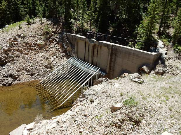 A gate covers the diversion tunnel leading from the Roaring Fork River near Lost Man Campground to Lincoln Gulch. The water is shipped to Grizzly Reservoir before entering another tunnel to be diverted east.