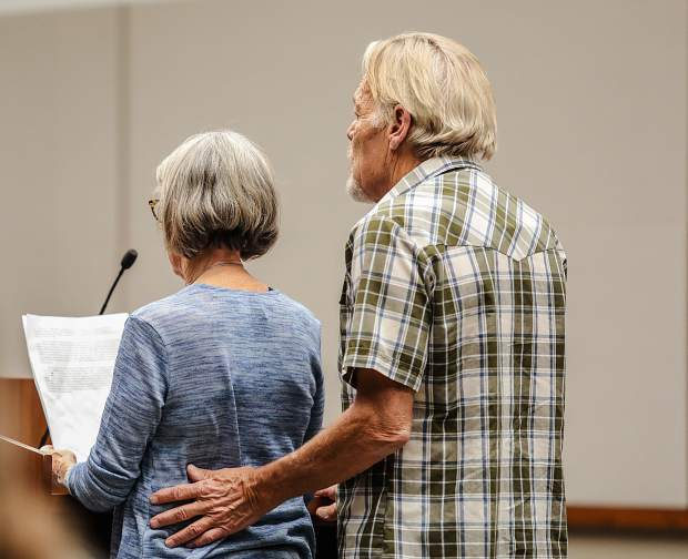 Bill McCauley comforts his wife, Andee, while she reads a statement Monday at a sentencing hearing for the defendants in the Lake Christine Fire case.