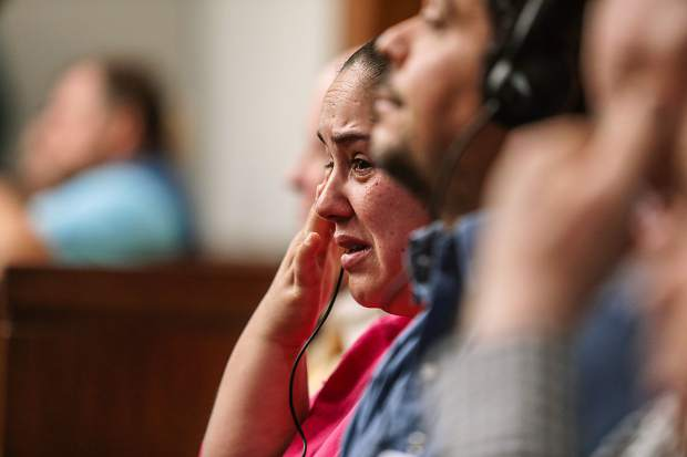 Griselda Sanchez cries during victim testimony during the sentencing of Allison Marcus and Richard Miller in Eagle County Court Monday. Sanchez and her family lost the house they rented.