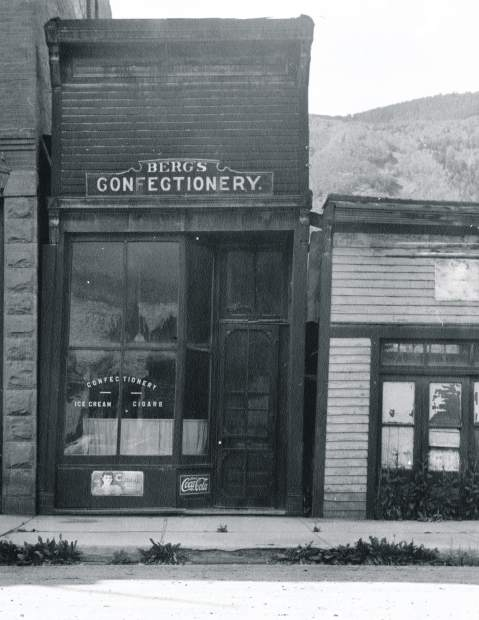 The window of Julius Berg's Confectionery on 419 E. Hyman Ave.advertises ice cream and cigars.