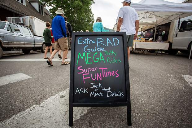 Ride Aspen uses a chalkboard at the Saturday Market to entice customers to