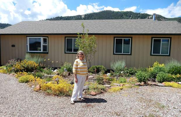 Marti Barbour stands in front of her 1,150-square-foot, ranch-style house in Emma. Valley residents rallied to aid the cause when Habitat For Humanity built its first house in the Roaring Fork Valley in 2000.