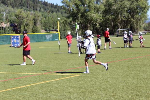 Storm Silich and Tyler Ward, who will both be Aspen High School juniors this fall, lead a lacrosse camp held July 8-10 at Iselin Field in Aspen. The camp was created in memory of Aspen Lacrosse Club founder Michael Goerne, who died in a winter avalanche.
