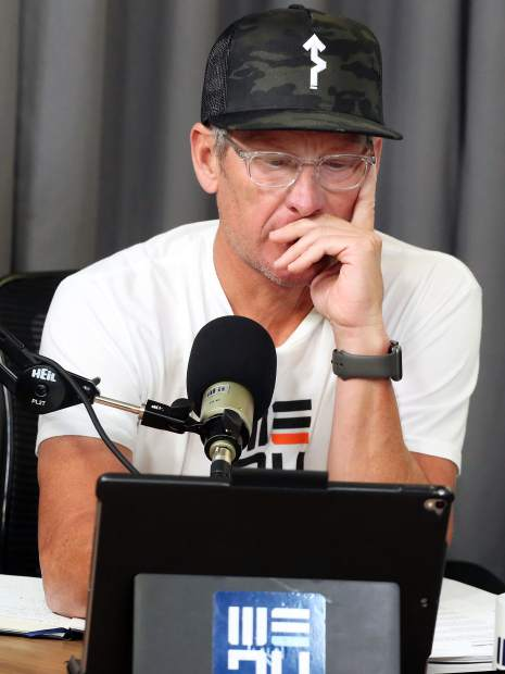 Lance Armstrong studies his notes prior to recording