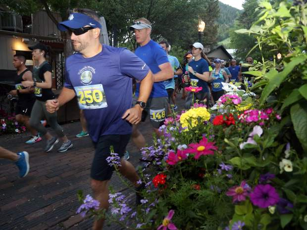 Runners take off from the start of the Aspen Valley Marathon on Saturday, July 13, 2019, in downtown Aspen. (Photo by Austin Colbert/The Aspen Times)