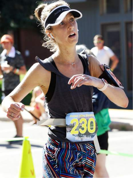 Lakewood's Rebecca Smith crosses the finish line after winning the Aspen Valley Marathon on Saturday, July 13, 2019. (Photo by Austin Colbert/The Aspen Times)