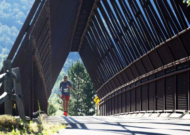 Broomfield's Tyler Arko crosses over a pedestrian bridge near Basalt during the Aspen Valley Marathon on Saturday, July 13, 2019. He finished 13th overall. (Photo by Austin Colbert/The Aspen Times)