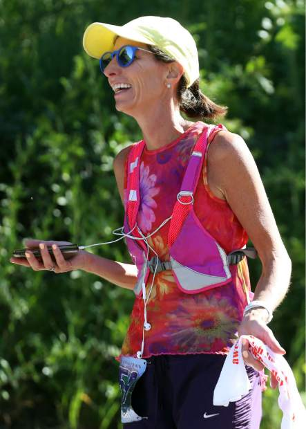 Aspen's Ashley Connolly laughs after winning the Aspen Valley Half Marathon on Saturday, July 13, 2019. (Photo by Austin Colbert/The Aspen Times)