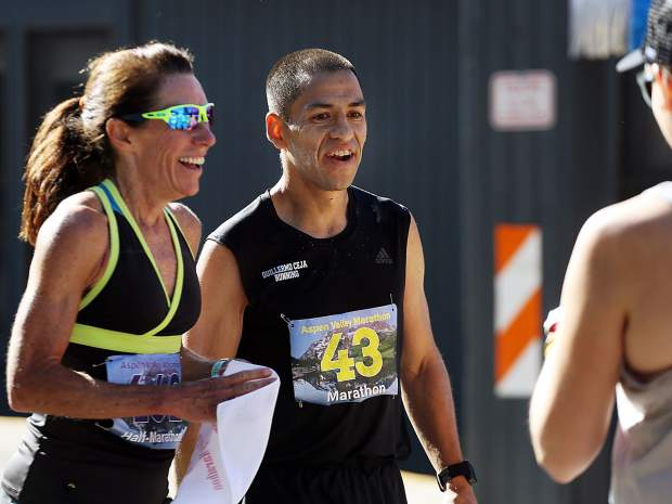 Carbondale's Guillermo Ceja, right, chats with Mary Cote of Snowmass Village after finishing the Aspen Valley Marathon on Saturday, July 13, 2019. (Photo by Austin Colbert/The Aspen Times)