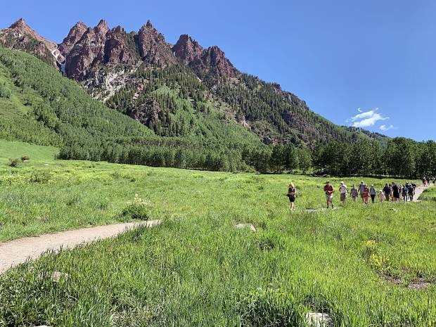 Aspen Skiing Co. provided some local media members with an e-bike ride to the Maroon Bells on Tuesday, July 9, 2019, as part of a celebration of the opening of the new Maroon Bells Basecamp at Aspen Highlands. (Photo by Austin Colbert/The Aspen Times)