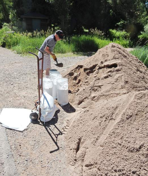 Hap Bruce fills sandbags Wednesday at his River Oaks neighborhood in Basalt. The longtime resident of the area wasn't worried about major flooding but wanted to shield a low spot in his yard on the Roaring Fork River.