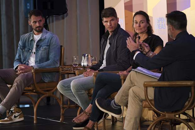 Skier Hilaree Nelson, second from right, talks June 25 during the Aspen Ideas Festival inside the Hotel Jerome Ballroom in Aspen. The panel was moderated by Jon Frankel, right, and included NBA players Kyle Korver and Kevin Love, far left.