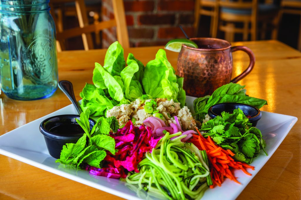 Chicken & shrimp lettuce wraps, leaf lettuce, cucumber, carrot, pickled cabbage and red onion, cilantro basil, mint, sides of ponzu and gochujan