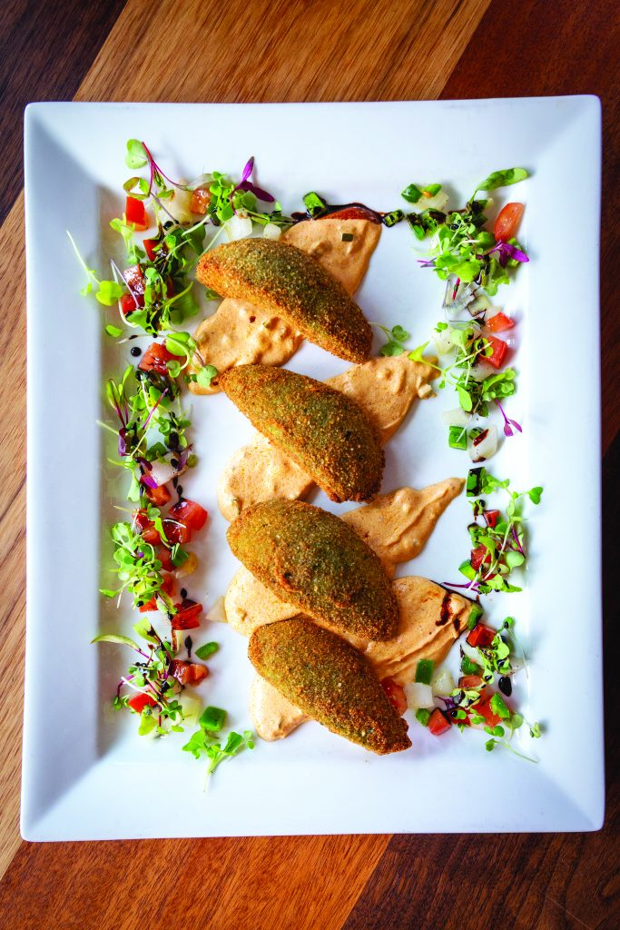 Fried breaded avocados with chipotle goat cheese sauce at Wienerstube in Basalt