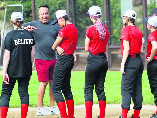 Aspen High School softball coach Dave Fuentes leads practice on Thursday, Aug. 15, 2019, at Upper Moore Field. (Photo by Austin Colbert/The Aspen Times)