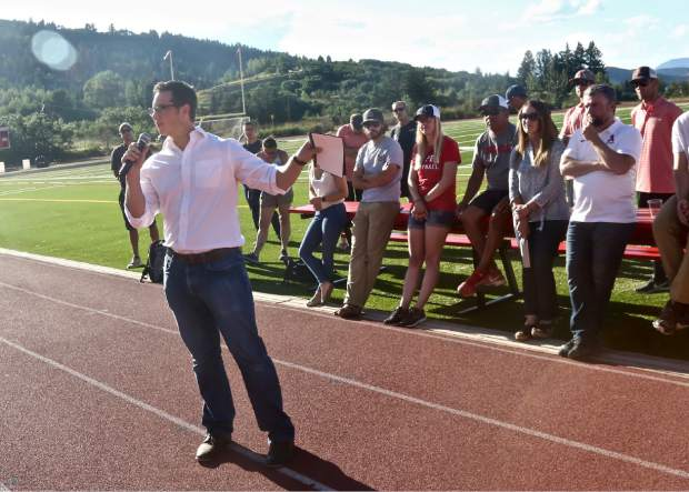Brock USA chief media officer Josh Palubicki talks to the crowd about the Aspen School Distrct's new turf field during their annual preseason barbecue event on Wednesday, Aug. 14, 2019, in Aspen. (Photo by Austin Colbert/The Aspen Times)